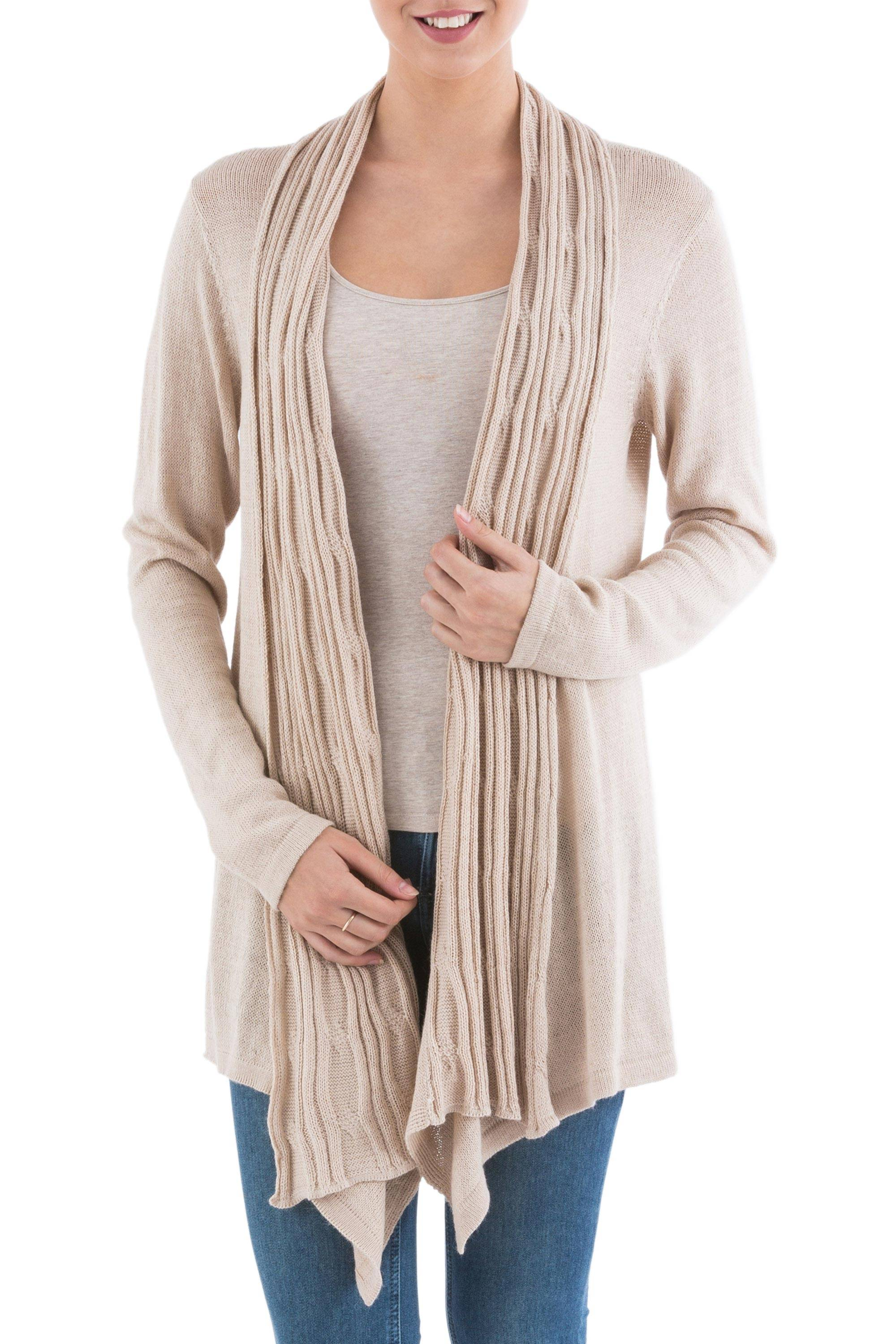 Revamp your wardrobe. Made from a soft blend of acrylic and alpaca wool, the long-sleeved light beige sweater has an open front with an attractive sidetail hem.
